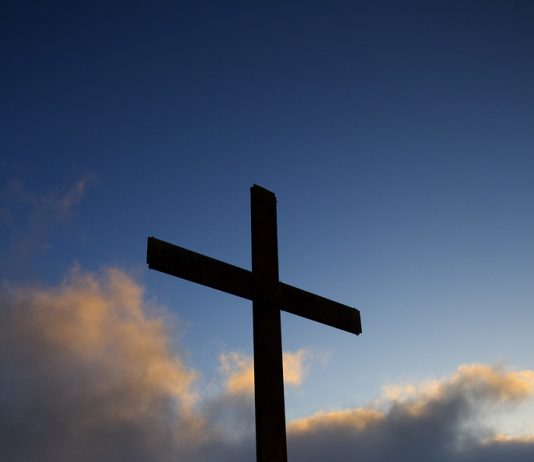 """Cross & Clouds"" by John H Wright Photo is licensed under CC BY-NC-ND 2.0"